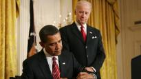 Barack Obama signs an executive order on January 30, 2009.